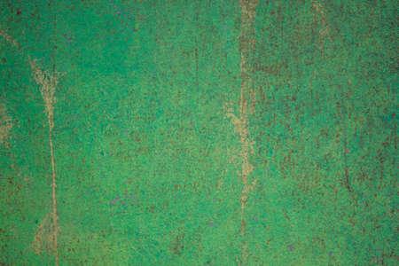 Worn dark green rusty metal texture background.