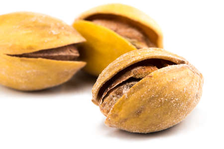 The Salted pistachios isolated on white background Stock Photo