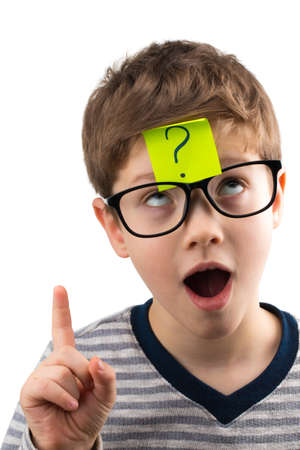 Confused boy with question mark on sticky note on forehead thought of an idea