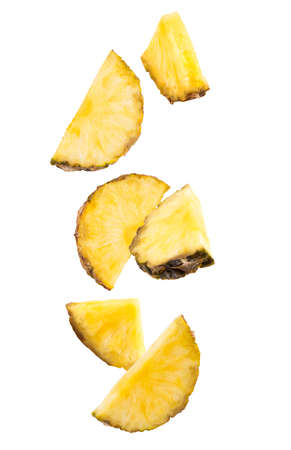 Falling slices of pineapple isolated on white. Stok Fotoğraf