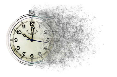 Time is running out concept shows clock that is dissolving away into little particles. Stockfoto