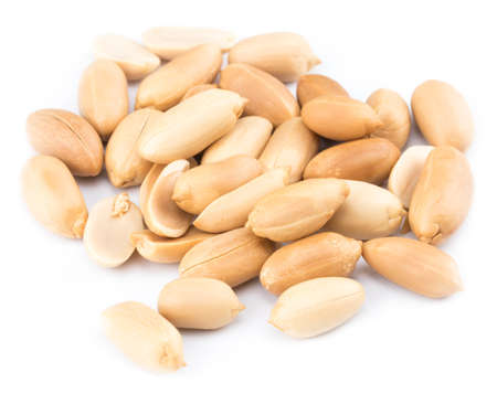 Peanuts isolated on the white background. Close up.