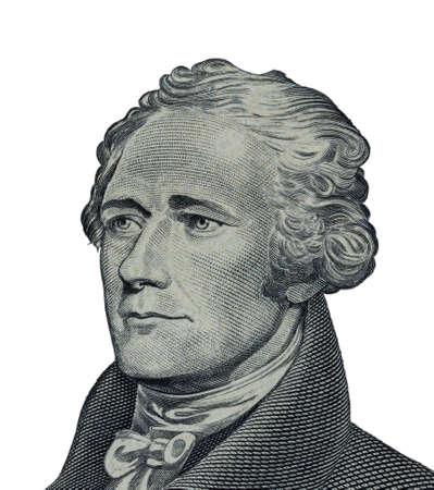 Alexander Hamilton face on US ten or 10 dollars bill macro united states money closeup on white background.