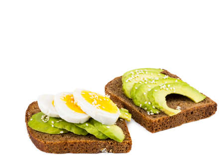Avocado toast with egg, on white background.