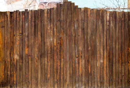 Old Wooden gate with door close up. Retro design. Banque d'images