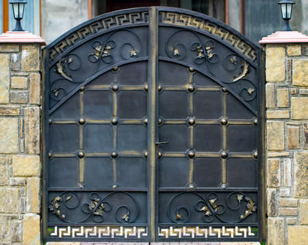 wrought-iron gates, ornamental forging, forged elements close-up.