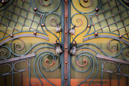 wrought-iron gates, ornamental forging, forged elements close-up. Archivio Fotografico - 99943468