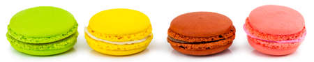Macaron or macaroon on white background,. Colorful almond cookies on dessert top view. Banque d'images