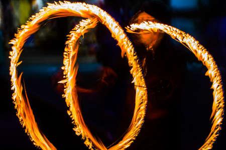 Fire dancers Swing fire dancing show fire show dance man juggling with fire. Stock Photo