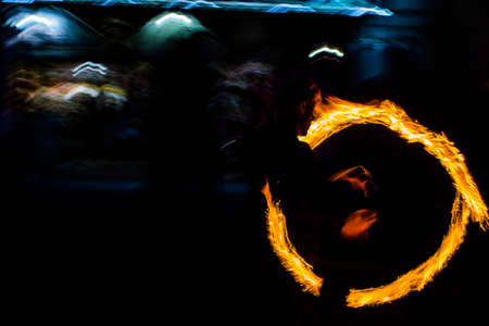Fire dancers Swing fire dancing show fire show dance man juggling with fire. Stock Photo