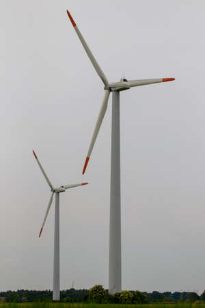group of windmills for renewable electric energy production. Stock Photo