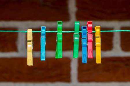 Colorful clothespin, clothespins on the rope close up. Stock Photo