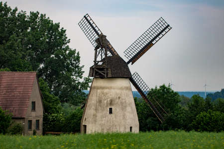Old windmill by cloudy day, Europe, Germany.