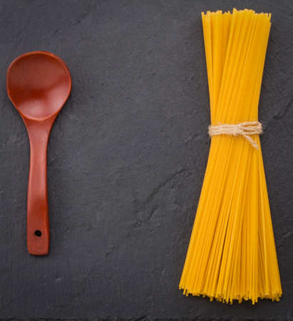 Italian food background with spaghetti. Slate background,food and healthy diet, copy space, closeup.