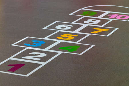 Hopscotch game drawn on to a pavement. Stockfoto