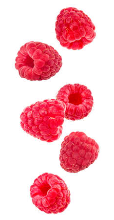 Falling raspberries isolated on a white background.