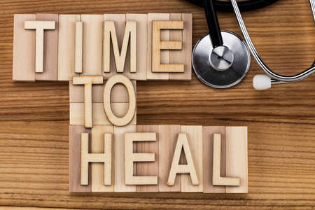 time to heal-  text in vintage letters on wooden blocks. Medicine concept. Stock Photo