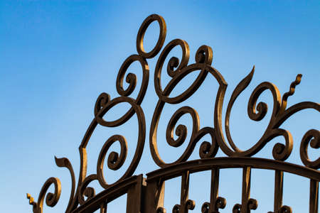 Wrought-iron gates, ornamental forging, forged elements close-up. Imagens