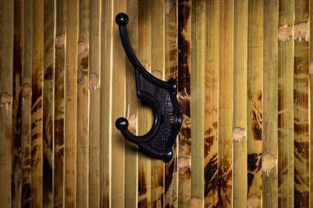 Close Up of iron hook for clothes on a wooden