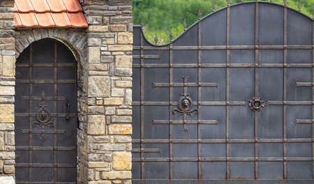 Wrought-iron gates, ornamental forging, forged elements close-up..