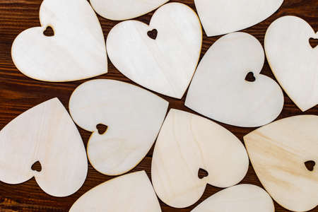Wooden hearts placed nicely on a wooden
