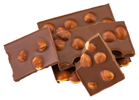 Chocolate pieces with nuts isolated on white Banco de Imagens - 128564097