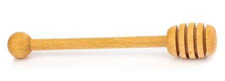 Wooden honey stick isolated on white