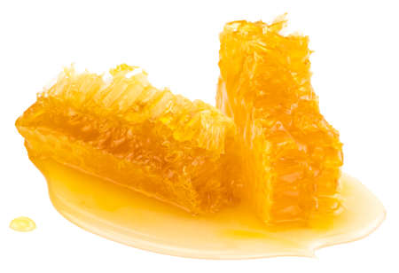 Honeycomb piece. Honey slice isolated on white with clipping path. Imagens