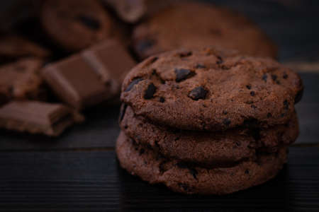 Chocolate cookies on wooden table. Homemade food on wooden