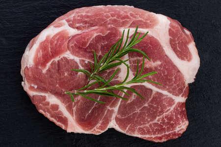 Raw meat, steak on black Stock Photo