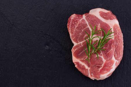 Raw meat,  steak on black