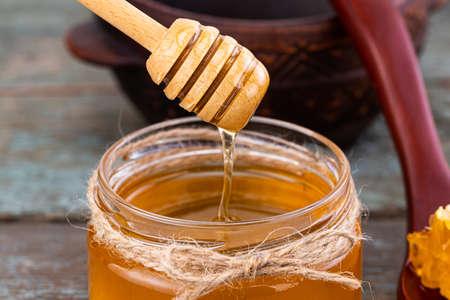Fresh honey in the pot with sunflower flower. Stock Photo