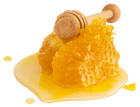 Honeycomb with honey dipper isolated on white