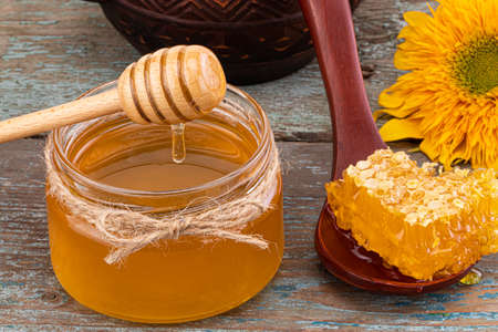 Honey background. Fresh honey in the pot with honeycombs.