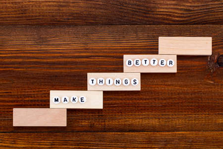 Make things better - Improvement Concept, wooden background. Stock Photo