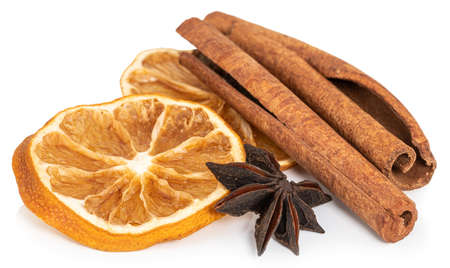 Cinnamon sticks, slices of dried lemon, star anise isolated on white background.
