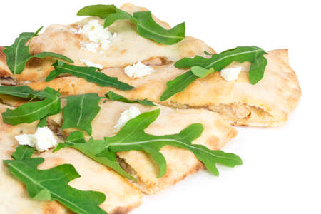 calzone with fresh arugula isolated on white background.