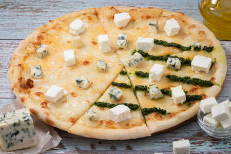 Pizza four cheeses on white wooden table. Stockfoto