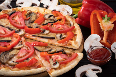 Pizza vegetarian with eggplant and tomato mushrooms on wooden background. Stockfoto