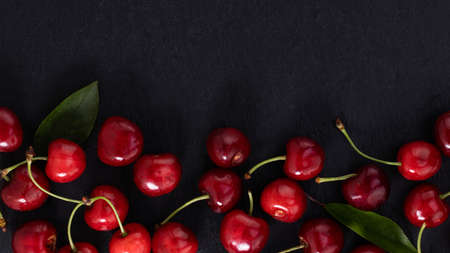 cherry on dark background with copy space. Top view. Flat lay. Stok Fotoğraf