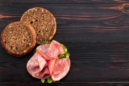 Ham sandwich on dark wooden Stok Fotoğraf