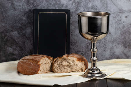 holy communion chalice with wine and bread. Stok Fotoğraf