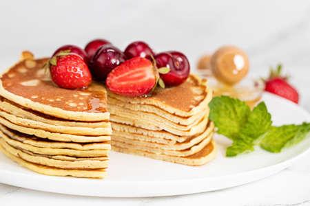 Pancake breakfast. Homemade pancakes with fresh berry and honey.