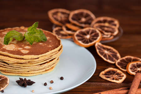 Homemade pancakes with spices, cinnamon and dried orange.