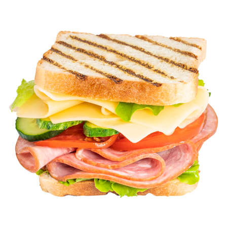 Sandwich with ham, cheese, tomato, lettuce and toasted bread isolated on a white background. Фото со стока