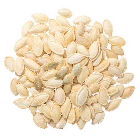 Pumpkin seeds isolated on white Фото со стока