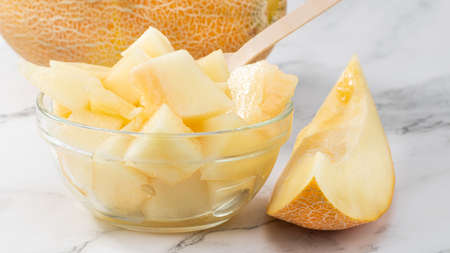 Sliced to pieces of melon. Melon Cut in a Bowl.