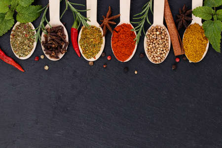 Various spices on dark background. Top view with copy space.