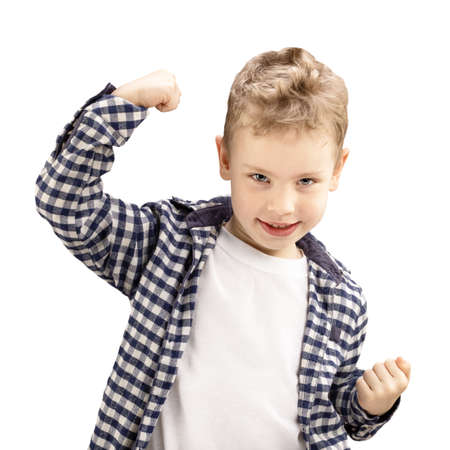 little boy showing his hand biceps muscles strength isolated on white background. Фото со стока