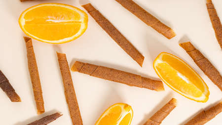fruit roll up with orange top view. Pattern of fruit pastille. Vegan homemade sweets. Фото со стока